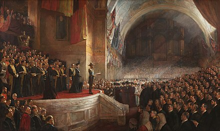 The Big Picture, the opening of the first Parliament of Australia on 9 May 1901, painted by Tom Roberts. Opening of the first parliament.jpg