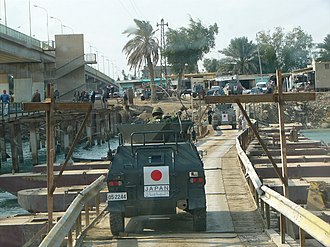 Komatsu LAV - A Komatsu LAV with Japanese Iraq Reconstruction and Support Group markings in Samawa.