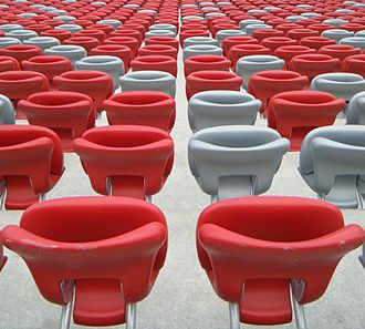 Folding seat - Standard folding stadium seats, type: FCB in red and silver colors in the National Stadium, Warsaw