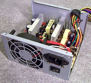 Power supply unit (computer) - An ATX power supply unit with top cover removed