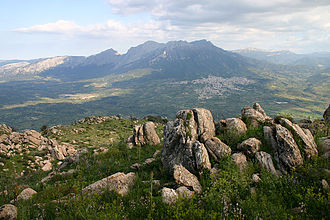 Oliena - Oliena, on the right, with the Mount Corrasi in the background.
