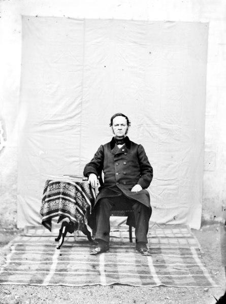 """Fonds Trutat - Photographie ancienne  Cote: TRU C 1152 Localisation: Fonds ancien (S 30)  Original non communicable  Titre: Papa [M. Trutat père], Montastruc  Auteur: Trutat, Eugène Rôle de l'auteur: Photographe  Lieu de création: Montastruc (Haute-Garonne) Date de création:  1859-1910 [entre]  Mesures:: 12 x 9 cm  Observations:  Notes de la main de E. Trutat: """"coll. humide""""  Mot(s)-clé(s):  -- Homme -- Costume masculin -- Portraits -- Table -- Décor d'ameublement -- Rideau -- Atelier d'artiste -- Photographie -- Nappe -- Chaise -- Tapis -- Sol -- Assis -- Face (de)  -- Montastruc (Haute-Garonne) -- Montastruc (Haute-Garonne; canton) -- Midi-Pyrénées (France)  -- 19e siècle, 2e moitié -- 20e siècle, 1e quart  Médium: Photographies -- Négatifs sur plaque de verre -- Noir et blanc -- Portraits   numerique.bibliotheque.toulouse.fr/cgi-bin/library?c=phot...  Bibliothèque de Toulouse. Domaine public"""
