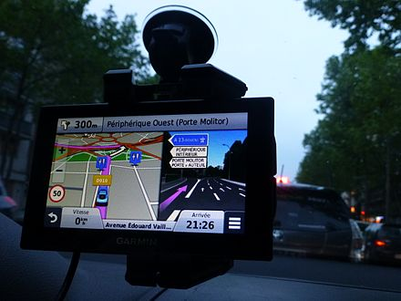 A personal navigation assistant GPS receiver in a car, which can give driving directions to a destination. Paris-PorteMolitor-GPS.jpg