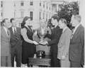 Photograph of President Truman and President's Cup Regatta Queen Drucie Snyder presenting the President's Cup to... - NARA - 199418.tif
