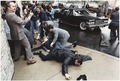 Photograph of chaos outside the Washington Hilton Hotel after the assassination attempt on President Reagan - NARA - 198514.tif