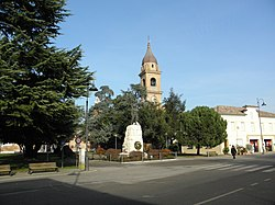 The central IV Novembre Square with the War Monument and the Saint Stephen church tower