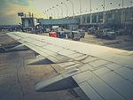 Plane at the gate (16451795034).jpg