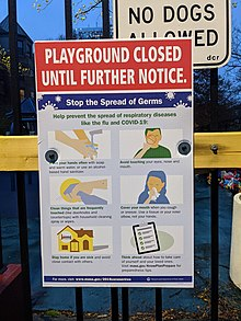 Sign on a gate of a playground, advising that the playground is closed until further notice due to the coronavirus pandemic, and instructing users to wash their hands, avoid touching their face, clean things that are frequently touched, cover their mouths when coughing and sneezing, stay home if they're sick, and think ahead about how to take care of themselves and their loved ones.