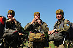 Polish paratroopers strap on their helmets during exercise Rapid Trident 2013 in Yavoriv, Ukraine, July 9, 2013 130709-A-ZZ999-005.jpg