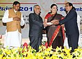 Pranab Mukherjee presenting the National Award for Teachers-2014 to Shri Pardeep Govind Masurkar, Goa, on the occasion of the 'Teachers Day', in New Delhi. The Union Minister for Human Resource Development.jpg