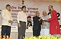 Pranab Mukherjee presenting the Rajat Kamal Award for Best Audiography Do Din Ka Mela (Kutchi) in Non Feature Film Section to the Audiographer, Shri Harikumar M, at the 60th National Film Awards function.jpg