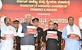 Pranab Mukherjee releasing a book at the inauguration of the Centenary Celebrations of the Federation of Karnataka Chamber of Commerce and Industry (FKCCI), in Bangalore. The Governor of Karnataka.jpg