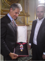 The recreated great Golden Fleece of King Louis XV of France, presented by H. Horovitz (left) and François Farges [fr] (right) at the Hôtel de la Marine, formerly the royal Storehouse in Paris on June 30, 2010