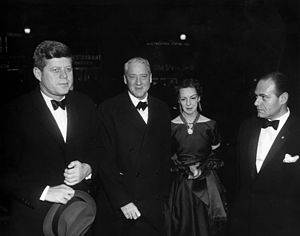The World of Apu - U.S. President John F. Kennedy arrives at the Dupont Theater in Washington, D.C. for a screening of the film, 16 February 1961.