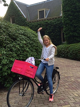 Bicycle monarchy - Catharina-Amalia, Princess of Orange, on a bike, on her way to school