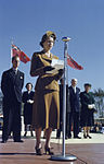 Princess Elizabeth and Duke of Edinburgh speaking on a microphone holding papers. Royal Visit 1951..jpg