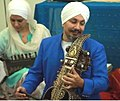Professor Surinder Singh Matharu playing Indian classical music in Parliament.jpg