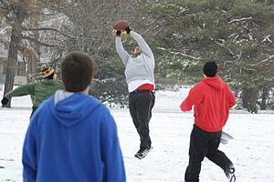 Street football (American) - QCBFL Football - Backyard football game in the snow. Vander Veer Park (Davenport, Iowa)