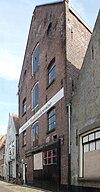 foto van Pakhuis gebouwd in 1875 gelegen in de kern van de middeleeuwse vestingstad