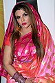 Rakhi Sawant snapped attending a press conference (05).jpg