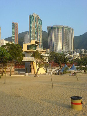 """Repulse Bay - Repulse Bay Beach. The curved building is the background is """"The Lily""""."""