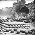 Richmond, Va. Piles of solid shot, canister, etc., in the Arsenal grounds; Richmond & Petersburg Railroad bridge at right LOC cwpb.02741.tif