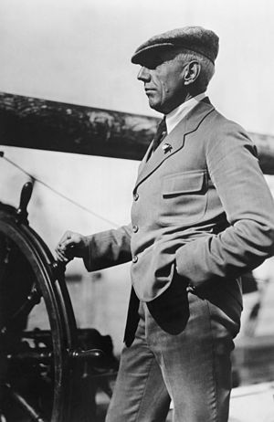 """Capt. Roald Amundsen at wheel leaving ho..."
