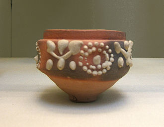 Ancient Roman pottery - A cup, 65 mm high, made at Aswan, Egypt, in the 1st–2nd century AD, and decorated with barbotine patterns