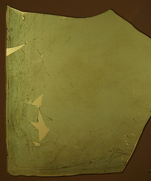 Window - Fragment of a Roman window glass plate dated to 1st to 4th century A.D. Note the obvious curvature, this is not a flat pane.
