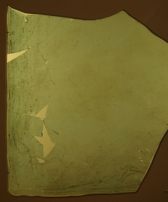 Plate glass - Fragment of a Roman window glass plate dated to 1st to 4th century CE