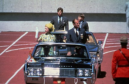 Four members of the Royal Family--Queen Elizabeth II; Prince Philip, Duke of Edinburgh; Prince Andrew; and Prince Edward--at the opening of the 1978 Commonwealth Games in Edmonton, Alberta Royal motorcade (8075978363).jpg