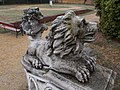 Rudnyánszky mansion. Stone lion at the south garden's stairs. - Budapest.JPG