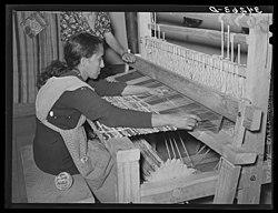 Photo of woman making a rug