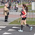 Running female marathon with headphone.JPG