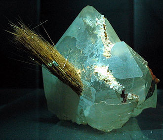 Rutile - Acicular crystals of rutile protruding from a quartz crystal