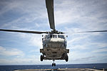 SH-60 Seahawk helicopter approaches flight deck of USS Cowpens 120704-N-TX154-038.jpg
