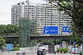 SZ 深圳 Shenzhen 南山 Nanshan 中山園路 Zhongshanyuan Road July 2017 IX1 building facade n blue signs n footbridge.jpg