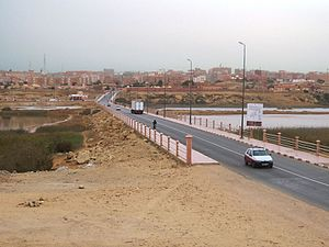 Transport in Western Sahara - The road into El Aaiún from the north crosses the Saguia el-Hamra, a seasonal river