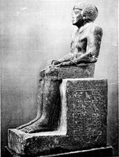 Statue of a seated man