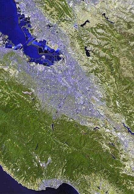 A satellite image of the Santa Clara Valley in the South Bay Area; San Jose makes up most of the urbanization in the center of the valley. San jose satellite map.jpg