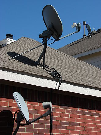 Television in the United States - Satellite TV receiver dishes.