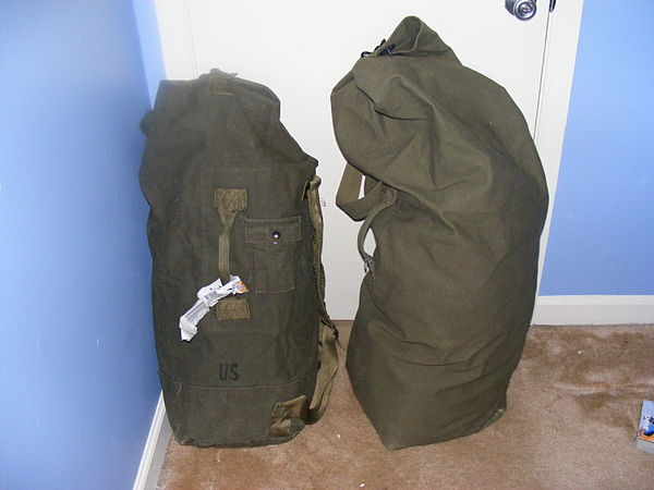 A duffel bag is a large cylindrical bag made of cloth with a drawstring  closure at the top. 9d606ec6c6