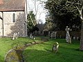Seat in the churchyard at St Peter's, North Mundham - geograph.org.uk - 1726987.jpg