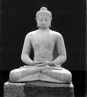 Pure Land Buddhism - Statue of Amitābha Buddha seated in meditation. Borobudur, Java, Indonesia.
