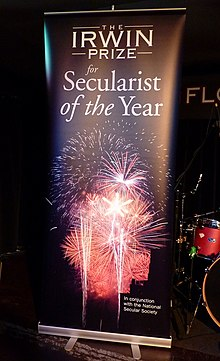 "A roll-up banner reading ""The Irwin Prize for Secularist of the Year"""