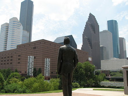 George H.W. Bush statue in Sesquicentennial Park looking towards Downtown Houston. SesquicentennialPark GeorgeHWBushStatue.jpg
