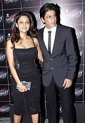 d31b01f83d Shah Rukh Khan standing beside his wife Gauri at a party in 2012