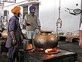Sikh Indian men cooking at volunteer run community kitchen, langar Goindwal Sahib.jpg