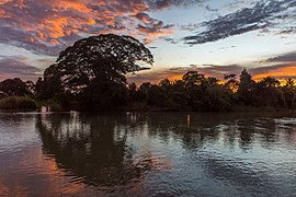 Silhouette of an island at dusk with red clouds in Don Det Si Phan Don Laos.jpg