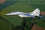 Slovak MiG-29 in flight over countryside.jpg
